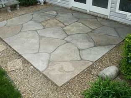 A small stamped concrete patio outside of a home in Beaumont, TX.