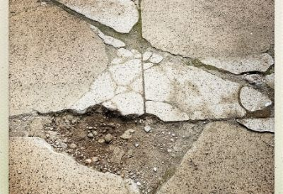 A cracked concrete driveway in Beaumont, TX